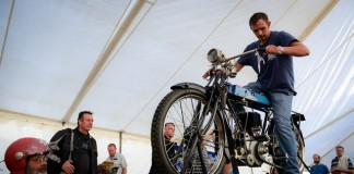 A man tries to start a motorcycle by British manufacturer Precision in 1912, which is one of oldest motorcycles displayed in the Classic Motorcycle Club 1000 Bike Show, in Johannesburg, South Africa, on July 4, 2015.The annual South Africa's Classic Motorcycle Club 1000 Bike Show was held here Saturday. Thousands of motor fans come to visit and purchase the displayed vintage, veteran and classic motorcycles of more than twenty global motorcycle manufacturers. (Xinhua/Zhai Jianlan)