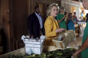 Democratic presidential candidate Hillary Clinton picks out fresh corn during a visit to Dimond Hill Farm in Hopkinton, New Hampshire July 28, 2015.