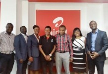 HAILE GEBRESELLASIE IN A POSE WITH DIRECTORS OF AIRTEL GHANA
