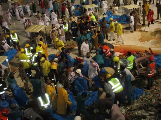 Saudi emergency teams gather inside the Grand Mosque of Saudi Arabia's holy Muslim city of Mecca after a construction crane crashed into it, on Sept. 11, 2015. 87 pilgrims were killed and 201 others were injured when a crane fell on the grand mosque in Mecca, Saudi Arabia's Civil Defence authority said Friday. Al Arabiya Television earlier said the crane had fallen because of strong storms. Saudi Arabia has been hit by strong sand storms in the last few days. (Xinhua/Str.)