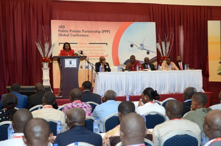 Mrs. Magdalene Apenteng,Director of the Public Investment Division of the Ministry of Finance addressing delegate at the conference