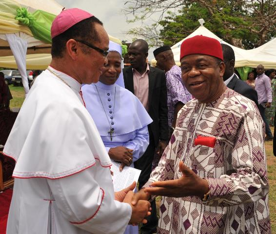 Gov. Theodore Orji of Abia State being received on arrival > by Most Rev. Lucius Ugorji, Catholic Bishop of Umuahia for the > Commissioning of New Classroom Block and Foundation laying for New > Classroom blocks at Holy Rosary Secondary School in Umuahia.