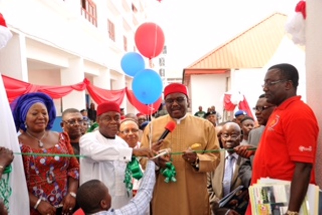 Prof. Onyebuchi Chukwu, Minister of health cutting the tape to inaugurate the Abia state Eye centre in Umuahia. with him from his immediate left are Gov. Theodore Orji of Abia state his wife Mercy and Dr. Okechukwu Ogah, Abia state commissioner for health among other state functionaries.