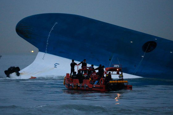 "Maritime police search for missing passengers near capsized South Korean ferry ""Sewol"" at the sea off Jindo"