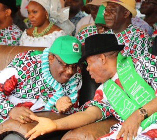 Gov. Theodore Orji of Abia state (right) chatting with Barr.Gov. Theodore Orji of Abia state (right) chatting with Barr.