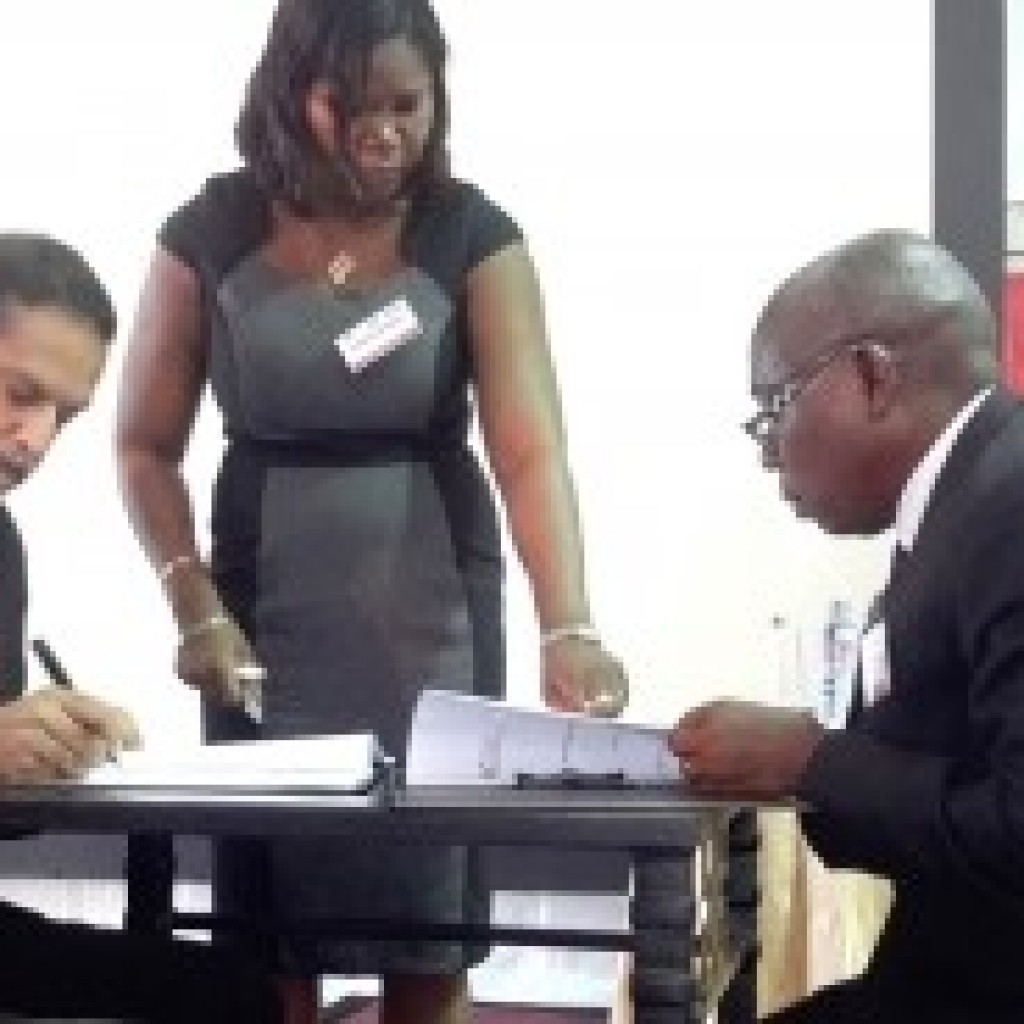 Managing Director of the GSE, Mr Kofi Yamoah, (right) and Chief Executive of SEM, Mr Sunil Benimadhu signing MoU