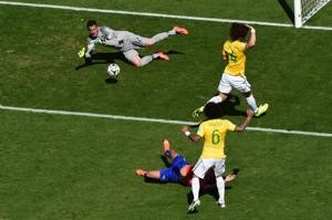 ? ? Brazil's goalkeeper Julio Cesar (top) makes a save during the World Cup clash against Chile
