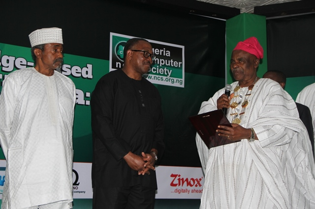 The President of the Nigeria Computer Society, Professor David O. Adewunmi (right), with the former President, Mr. Tunde Ezichi (left), during the presentation of Special Recognition Award to Mr. Peter Obi(middle), as part of the activities to mark our 25th National Conference at Enugu, for his massive deployment of ICT to Anambra State.