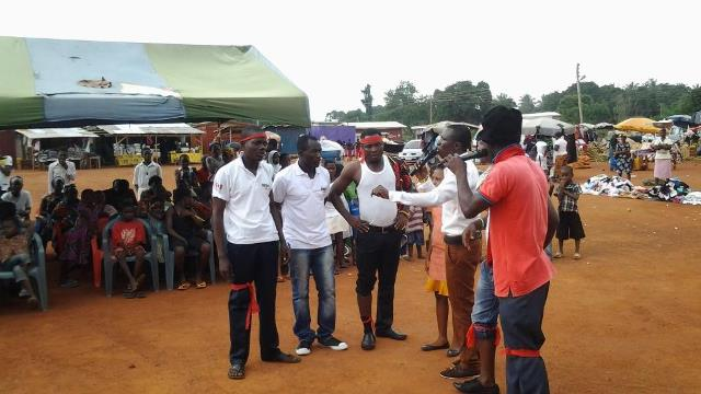 Pictures show a drama group displaying some drama to sensitize the people about the programme.
