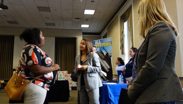 Job seekers attend a Job Expo job fair in Boston, Massachusetts
