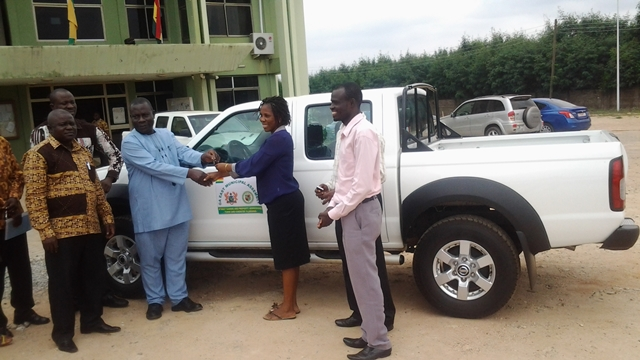 Pictures show Mr John Kwao Sackey, Municipal Chief Executive handing over the key to Mrs Doris Adusei, Head of Fiscal Department of the Assembly, standing by the MCE is the Municipal Coordinating Director, Mr Martin Dasa and some staff of the Assembly.