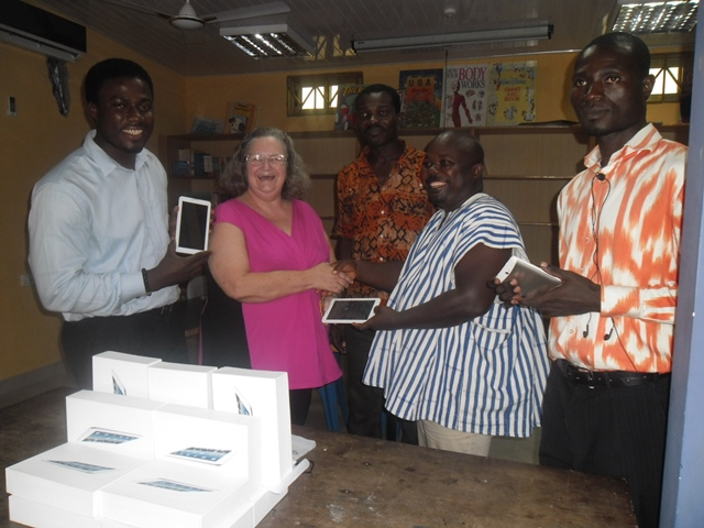 Picture shows Mr Quame Zowonu, Director of eSyllabus, West Africa presenting the tablets to Ms Elaine Brown, Project Coordinator in Charge with Social Work, SCEF while Mr Paul Semeh, Founder of SCEF at the extreme left admiring one of the tablets.