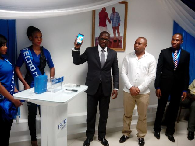 The CEO of Ghana Chamber of Telecommunications (black) and Managing Director of TECNO (white) unveil the new handset