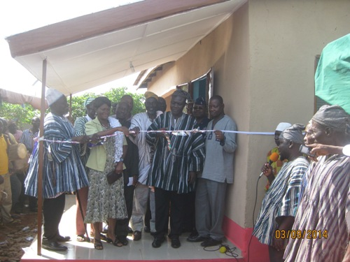 Mr Adam Imoro, the District Chief Executive (middle) cutting the tape to inaugurate.
