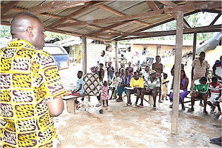 Mr. Seidu Mohammed, Occupational Hygienist on the Mine explaining the Ebola Viral Disease to residents of New Techiman community