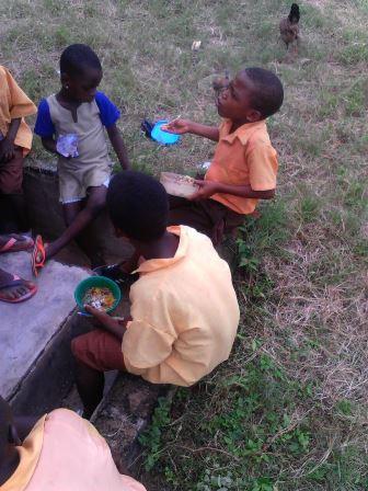 Pupils enjoying the school feeding programme