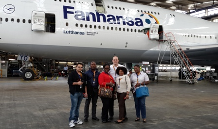 Mr Sachin Hiwale, Mr Ivan Bruce Cudjoe, Mrs Alberta Allen, Mrs Glory Brisbane, Mrs Peace Owuo in the front row, while Mr Kevin Markette, the Lufthansa General Manager- Ghana in the back row and ?Yankee Oscar? one of Lufthansa?s Boeing 747-8i jets.