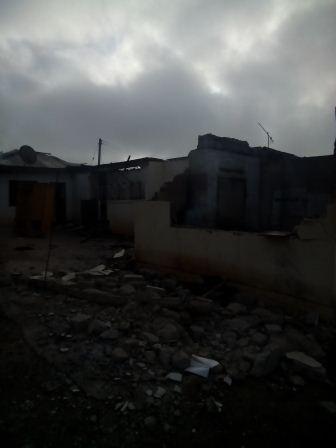 debris of the burnt house