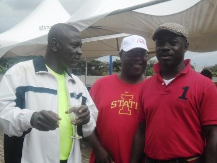 Mr Prince Kofi Amoabeng (left), UT Group President interacting with his staff.