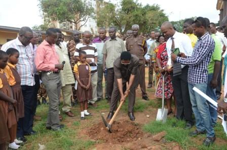 Mr Agyarko standing left looking on whilst Dr Vanderpuije is cutting the sod.