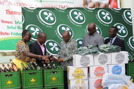 Ms Adjoba Kyiamah, Corporate and Legal Affairs Director and Mr Richard Edzeame, Supply Chain Director of ABL presenting Eagle Lager as part of the sponsorship package to Ahmed Alhassan Yakubu, Deputy Minister of Food and Agriculture in charge of Crops. Looking on are the Chief Director, Mr Maurice Tanko Abisa Seidu, and Mr Benjamin Gyasi, Director at MOFA
