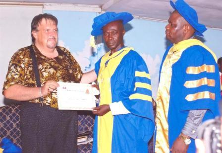 Dr Poku (middle), receiving the award from Archbishop Gilson J M Levi, President and Chancellor of Bishop Gilson University in the United Kingdom, (extreme left), whilst Bishop Nath Eze (extreme right), international affiliated leader of the College, and Africa Director of RCCG, looks on.