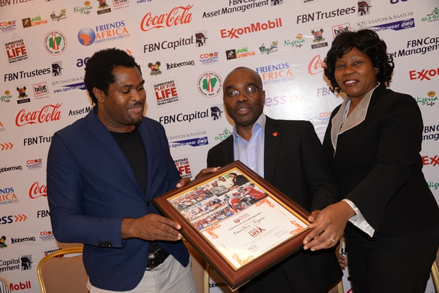 Director, Public Affairs and Communications, Coca-Cola Nigeria Limited, Mr. Clem Ugorji (middle), receiving a Certificate for Cooperative Participation from the Friends Africa Goodwill Ambassador, Mr Emmanuel Babayaro (Left),and CEO/Founder Friends Africa, Dr. Akudo Anyanwu Ikemba (Right) during the launch of Friends Africa 2014 Play for Life Campaign held on Thursday, 6th November, 2014 at Four Points by Sheraton Hotel in Lekki, Lagos