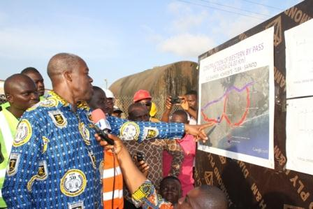 Vice President Amissah-Arthur looking at the drawings of the Kasoa by-pass