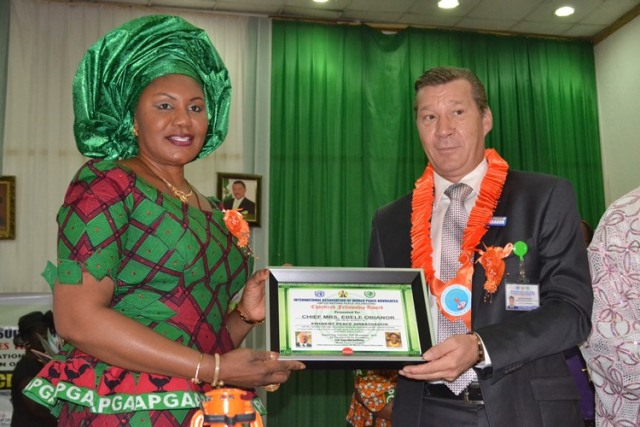 Chief (Mrs) Ebelechukwu Obiano, receiving the Eminent Ambassadors of Peace Award from the World Peace Vice President and Chairman Governing Council Board, His Excellency Chief Ambassador. Per Stafsen during the United Nations International Day for the Elimination of Violence against Women organized by the International Association of World Peace Advocates at Women Development Centre (WDC), Awka on 25/11/14.