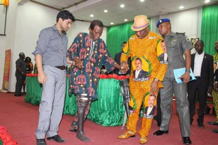 Chief Willie Obiano, Governor of Anambra State leading Mr. Benson Igbokwe, beneficiary of the governor's gift of prosthetic limbs to Amputees and Mr. Denish Rathi, representative of Tolaram Foundation at the giving of Prosthetic Limbs to Amputees in Awka...Tuesday.
