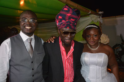 Kojo Antwi (middle) in a pose with Bobie Ansah and his wife Aku.