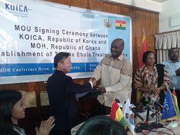 Korean Ambassador, Woon-Ki Lyeo, shaking hands with Health Minister Dr Kwaku Agyeman-Mensah after signing the MOU