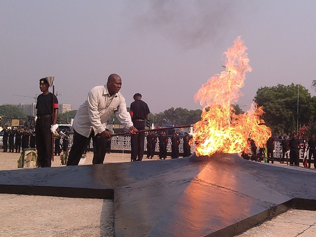 Mr Kofi Portuphy, National Chairman of the National Democratic Congress lighting the perpetual flame at the Revolution Square in Accra