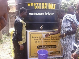 Nii Okpelor Sowah Ablorh drinking water after commissioning borehole