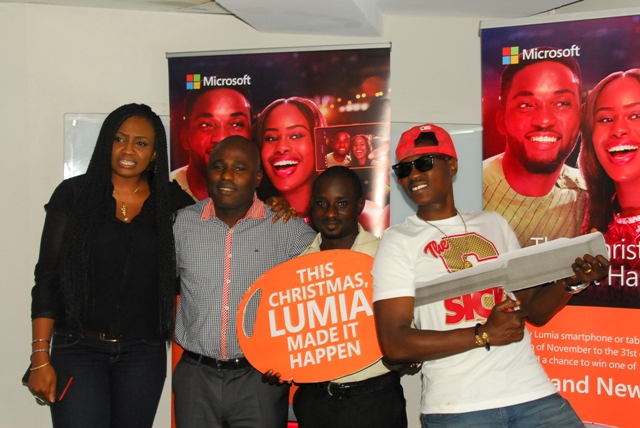 L-R: Rhythm On-air personality, Anita Isedeh popularly known as Omolicha; Product Manager, Microsoft Mobile Devices and Services;Babajide Ekundayo, 8th Winner of the on-going Lumia Christmas Promo ?#MakeItHappen?, and the Nigerian Singer-songwriter, Olanrewaju Fasasi, popularly known as Sound Sultan during the Lumia Christmas Promo third draw held in Lagos recently.
