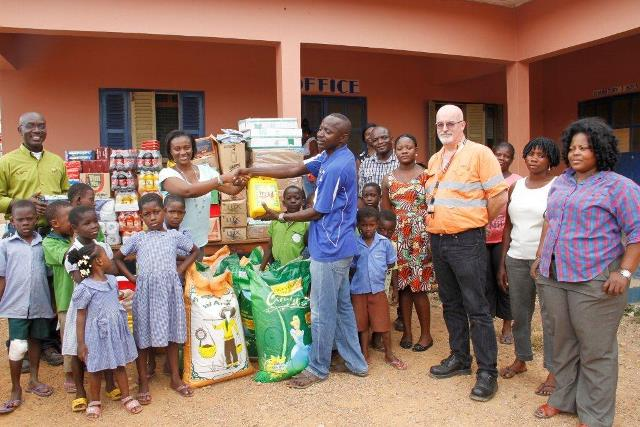 AGA's Delanyo Aheto-Tsegah presenting the items to Pastor James