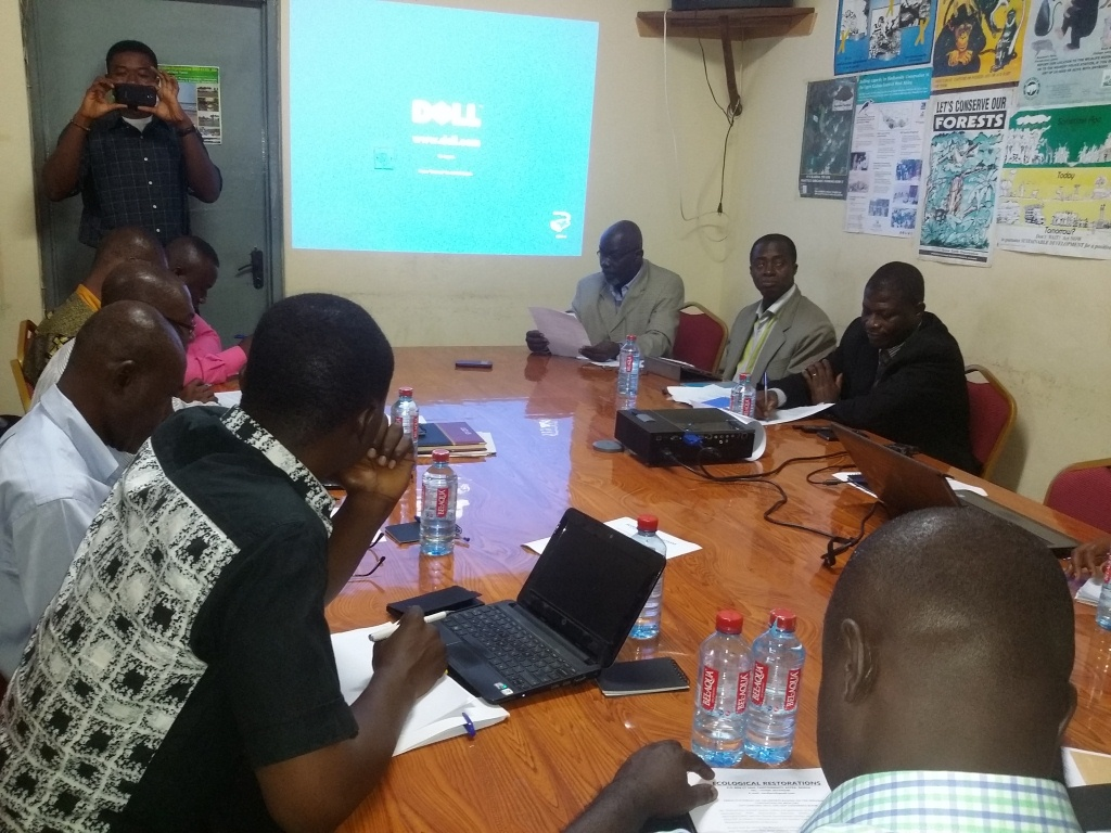 Mr Emmanuel Odjam-Akumatey, Executive Director delivering his speech and seated are some participants in the discussion