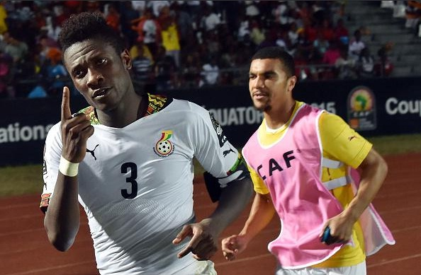 Asamoah Gyan celebrates his last gasp winner against Algeria