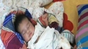 CCTV image of one of the babies rescued during a raid on child traffickers in China?s Shandong.
