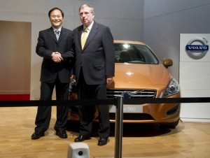 Chairman of Zhejiang Geely Holding Group Li Shufu (L) and former Executive Vice President and Chief Financial Officer of Ford Lewis Booth shake hands in front of a Volvo S60 car in the Volvo Hall at the Volvo plant and headquarters in Torslanda, Gothenburg in this March 28, 2010 file photo