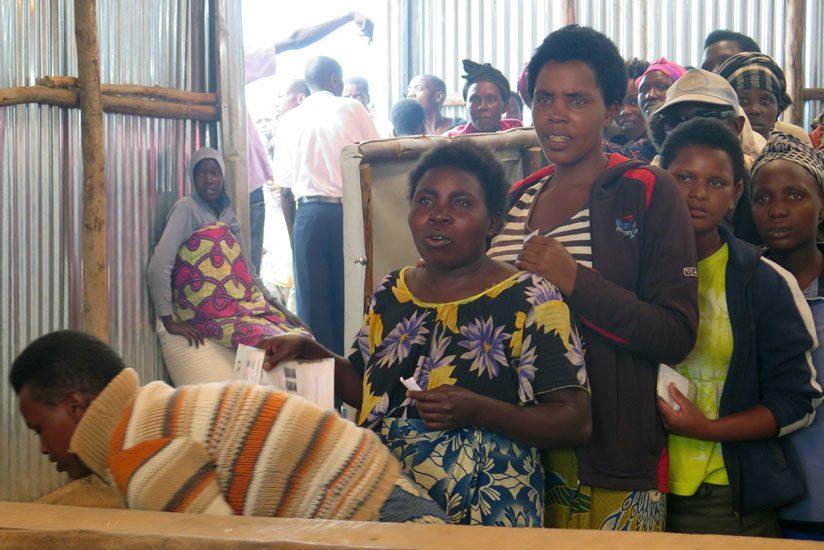 Refugees line up to get food rations in Kigeme camp on monday. (JP. Bucyensenge)