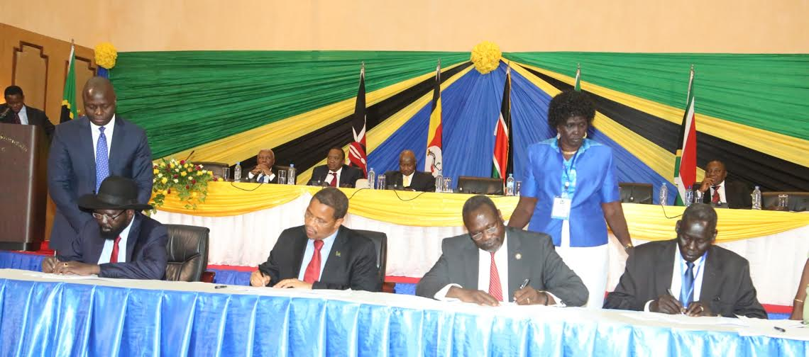 CCM National Chairman, President Jakaya Kikwete, South Sudan President Salva Kiir Mayardit (left), former South Sudan Vice-President Riek Machar Teny (second right) and Mr Deng Alor Kuol sign an agreement to reunite the SPLM factions in Arusha yesterday. Looking on are the widow of the late SPLM Chairman John Garang, Ms Rebecca Nyandeng de Mabior, and an official from the Ministry of Foreign Affairs and International Cooperation, Mr Thobias Makoba.