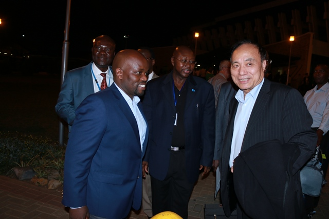 The Secretary-General of ITU, Zhao Houlin (R) chats with Minister Nsengimana on his arrival at Kigali International Airport this evening