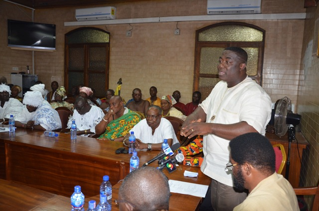 shows the Regional Minister addressing the AMA staff and the Ga chiefs
