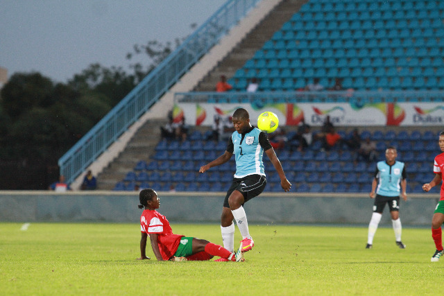 Thato Bame (2nd L) of Botswana's national women football team vies with Abigail Kozik (1st L) of Madagascar's national women football team during the All Africa Games qualifiers in Gaborone, capital of Botswana, March 6, 2015. Botswana advanced to the next round of the All Africa Games qualifiers after knocking out Madagascar 3-2 on aggregate. (Xinhua/Koone Boikaego)