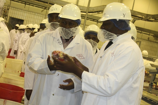 Bosiela Saudu (R), Botswana Meat Commission (BMC) Plant Manager shows Ghana's President John Dramani some of the meat processed at the Francistown abattoir (slaughterhouse), about 430 kilometers northeast of Gaborone, capital of Botswana,March 10, 2015. John Dramani who is in Botswana for a three-day official visit toured the slaughterhouse on Tuesday, and promised to persuade the West African nations to import beef from Botswana. (Xinhua/Shingirai Madondo)