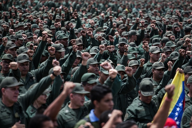 Soldiers take part in the military exercises convened by Venezuelan President Nicolas Maduro, in Caracas, Venezuela, on March 14, 2015. Venezuelan Defense Minister Vladimir Padrino Lopez inaugurated the ten-day military exercises on Saturday, which he said was launched due to the urgent need to defend the integrity of the nation. (Xinhua/Boris Vergara) (jg)