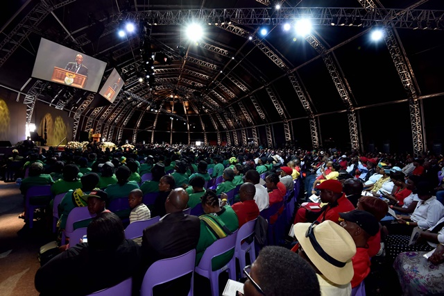 People attend the funeral service of South African anti-apartheid hero Moses Kotane in Pella, North West Province, South Africa, on March 14, 2015. The mortal remains of South African anti-apartheid hero Moses Kotane was reburied on Saturday, with a grand ceremony attended by South Africa's President Jacob Zuma. (Xinhua/DOC/Elmond Jiyane)