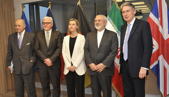France's Foreign Minister Laurent Fabius, Germany's Foreign Minister Frank Walter Steinmeier, EU High Representative for Foreign Affairs and Security Policy Federica Mogherini, Iran's Foreign Minister Mohammad Javad Zarif and British Foreign Secretary Philip Hammond (from L to R) pose for photos during a meeting of Iran nuclear negotiations in Brussels, Beglium, March 16, 2015. (Xinhua/Ye Pingfan)