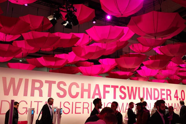Visitors view Deutsche Telekom's stand at 2015 CeBIT Technology Trade fair in Hanover, Germany, on March 16, 2015. Top IT business fair CeBIT 2015, which features a strong Chinese presence, opened on Sunday in Germany. (Xinhua/Zhang Fan)